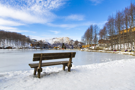 snowy landscape: View from the back of a wooden bench in a Tuscan snowy landscape
