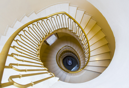 centering: View from the top of a spiral staircase of an old Tuscan home