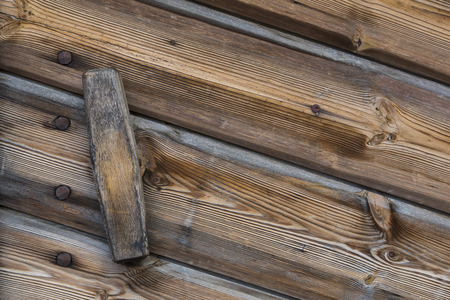 sud tirol: Close up view of a wooden handle of a door of a warehouse wood
