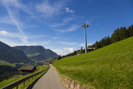 Bottom view of a cableway in a sunny day in Seiser Alm
