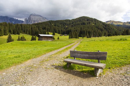 View of a bench near a hiking trail in Seiser Alm