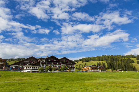 View of a group of houses in the village of Saltria in Seiser Alm