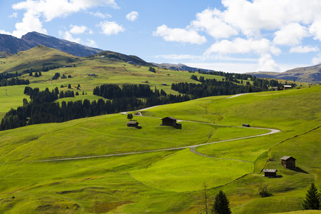 sud tirol: panoramic view of the Seiser Alm in a sunny day with blue sky and clouds