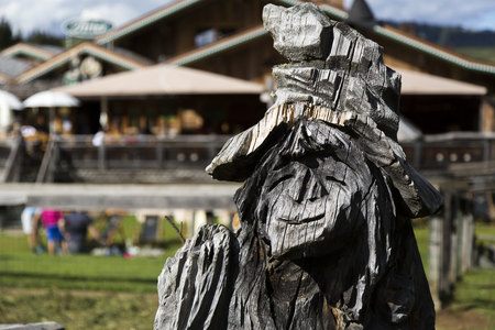 sud tirol: Close up view of a wooden statue of a witch Stock Photo