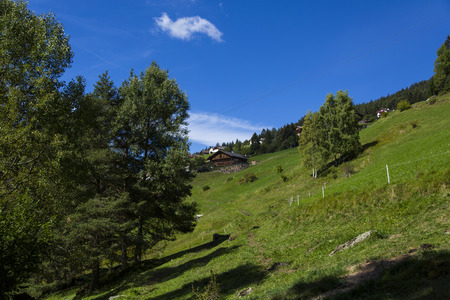 Distant view of a shelter in Seiser Alm on a sunny day Stock Photo