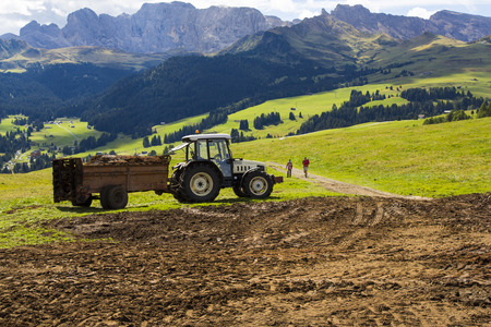 View of an agricultural tractor at work on a sunny day Editorial