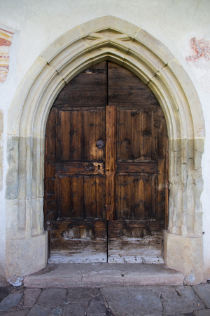 sud tirol: Front view of a wooden door of a church