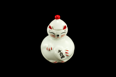maneki: A common Japanese figurine lucky charm, talisman which is often believed to bring good luck to the owner.