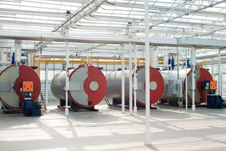 Row of industrial water boilers in a modern greenhouse