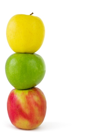 three objects: Vertical composition of three colorful apples, isolated on white background