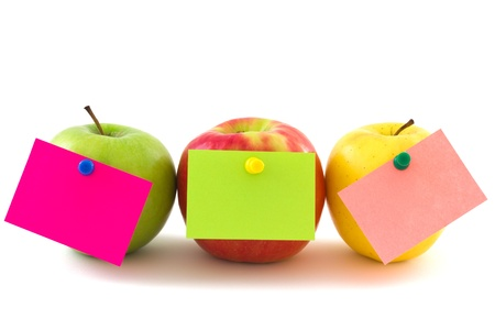 Three apples with colourfull memo stickers isolated on white background