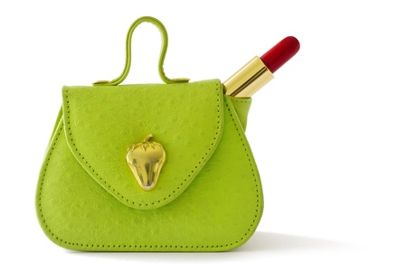 Small green bag and red lipstick, isolated on white background