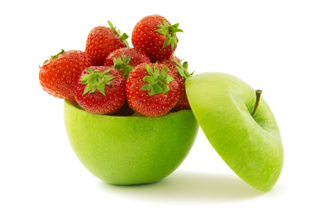 Green apple filled with ripe strawberries Stock Photo
