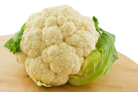 Whole Cauliflower on wooden board,  isolated on white  photo
