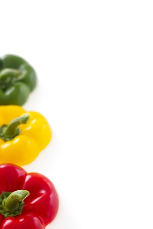 Three pepper bell tops isolated on white background