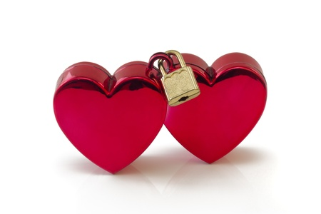 Two red hearts connected with padlock, isolated on white background photo