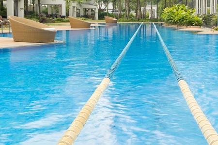 Swimming path in beautiful crystal cline swimming pool  photo