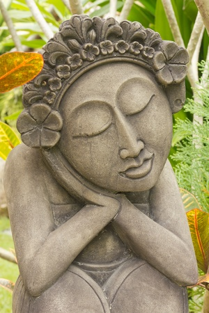Sweet woman sculpture in Thai garden  photo