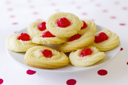 Home made cookies on red polka pot background  photo