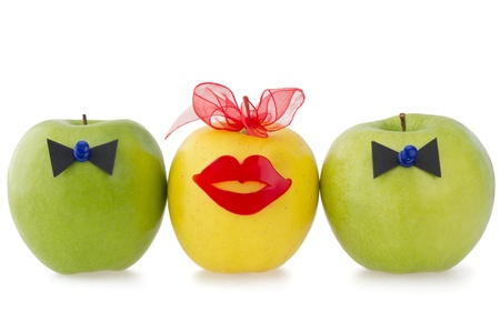 Three apples as a  concept of competition between two male over one female  Stock Photo