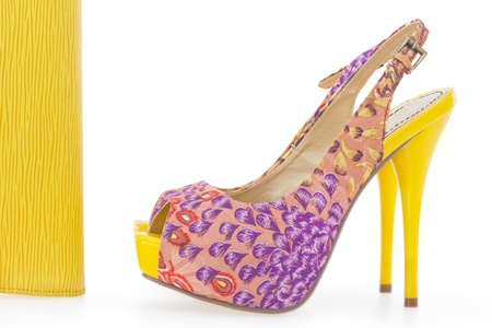 Pare of yellow women stiletto shoes with matching bag, isolated on white background Stock Photo - 15162284