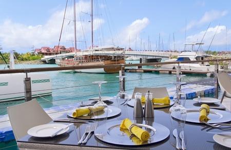 Table settings at restaurant on island