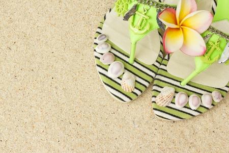 Green Sandals, seashells, and frangipani on sand Stock Photo - 16932363