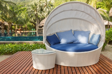 Nice cozy white round chair with canopy and blue cushions
