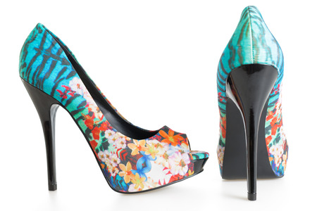 Pair of multicolored stiletto shoes on white background Stock Photo