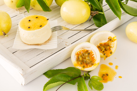 Passion fruit dessert with freshly cut maracuja or passion fruit Stock Photo