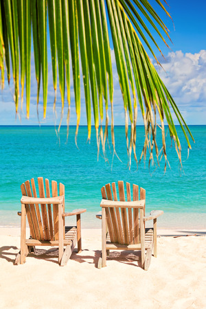 chairs: two beach chairs on tropical shore Stock Photo