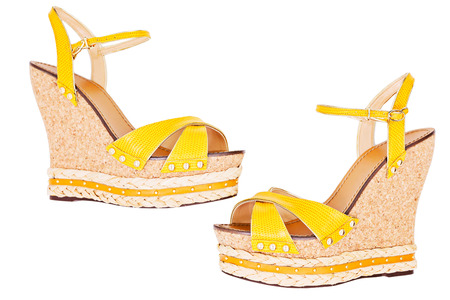 Ladies yellow Wedge platform sandals, isolated on white, top view Stock Photo