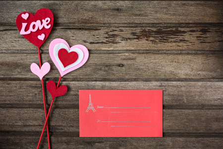 envelope decoration: Red envelope and valentine decoration with word LOVE on old wooden background