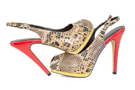 peep toe: Snake leather yellow and orange peep toe sling back pumps, isolated on white background