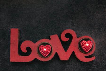 two on top: Word Love, with two small red candle, top view