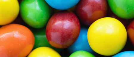 colorant: Colorful background of assorted rainbow Choco coated  peanut , letterbox format Stock Photo