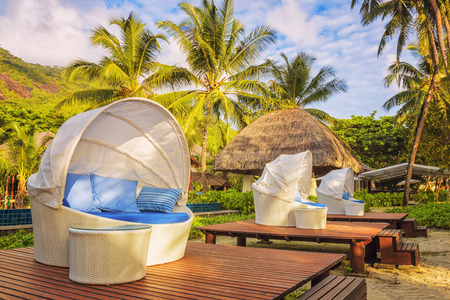 round chairs: Nice cozy white round chairs with canopy and blue cushions on beautiful tropical resort background