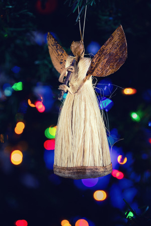 boke: Figure of an angel decorating on Christmas tree with nice colorful boke background
