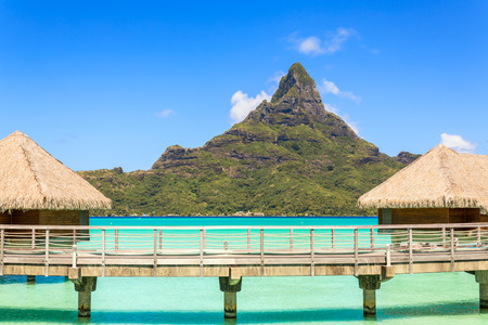 borabora: Otemanu mountain view and traditional overwater bungalows with stunning lagoon at Bora-Bora, Tahiti, French Polynesia Editorial