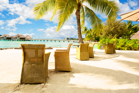 otemanu: Two chairs and on a sand beach with a view on the lagoon and Mount Otemanu on the tropical island of Bora Bora, near Tahiti, in French Polynesia. Stock Photo