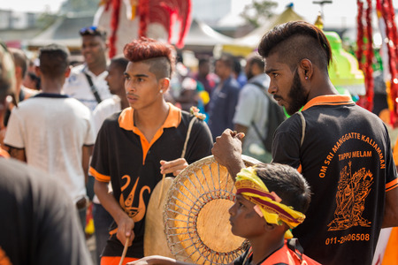 Georgetown, Penang, Malaysia - February 9, 2017 : Group of young musicians as a Hindu devotee taking part in the Thaipusam festival on February 9, 2017 in Malaysia. Hindu festival to worship God Muruga.
