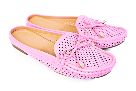 Women pink flats slip-on with small ribbon shoes isolated on white background Stock Photo