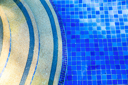 Top view of blue water and stairs in swimming pool