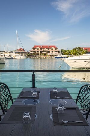 Luxury yachts and Boats  in sunny summer day at marina of Eden Island, Mahe, Seychelles