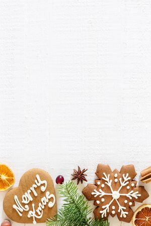 Ginger bread cookies on white Christmas background with copy space , vertical composition Stock Photo