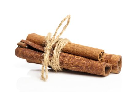 Cinnamon sticks, close up on white background, isolated