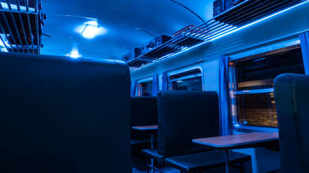 Vintage train carriage at night