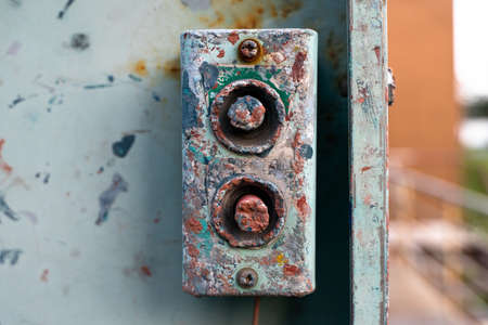 Old and damaged button switch