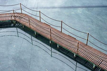 Small metal bridge on the water