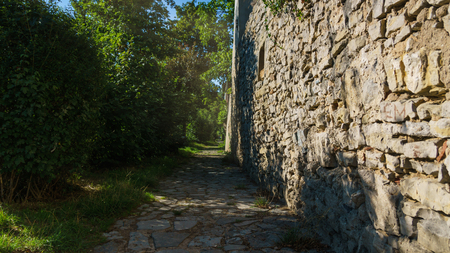 near death: Sunny Path with a Stone Wall in Nature
